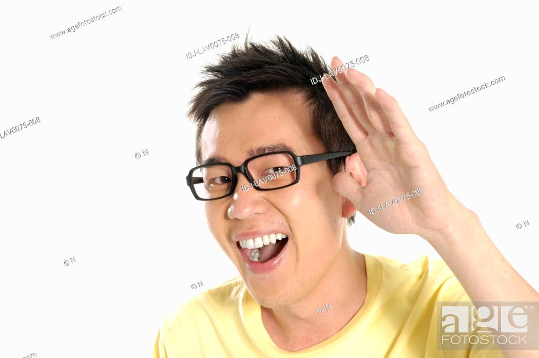 Stock Photo: Male university student gesturing and laughing.