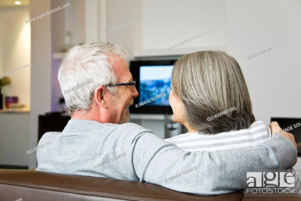Stock Photo: Mature couple watching television.