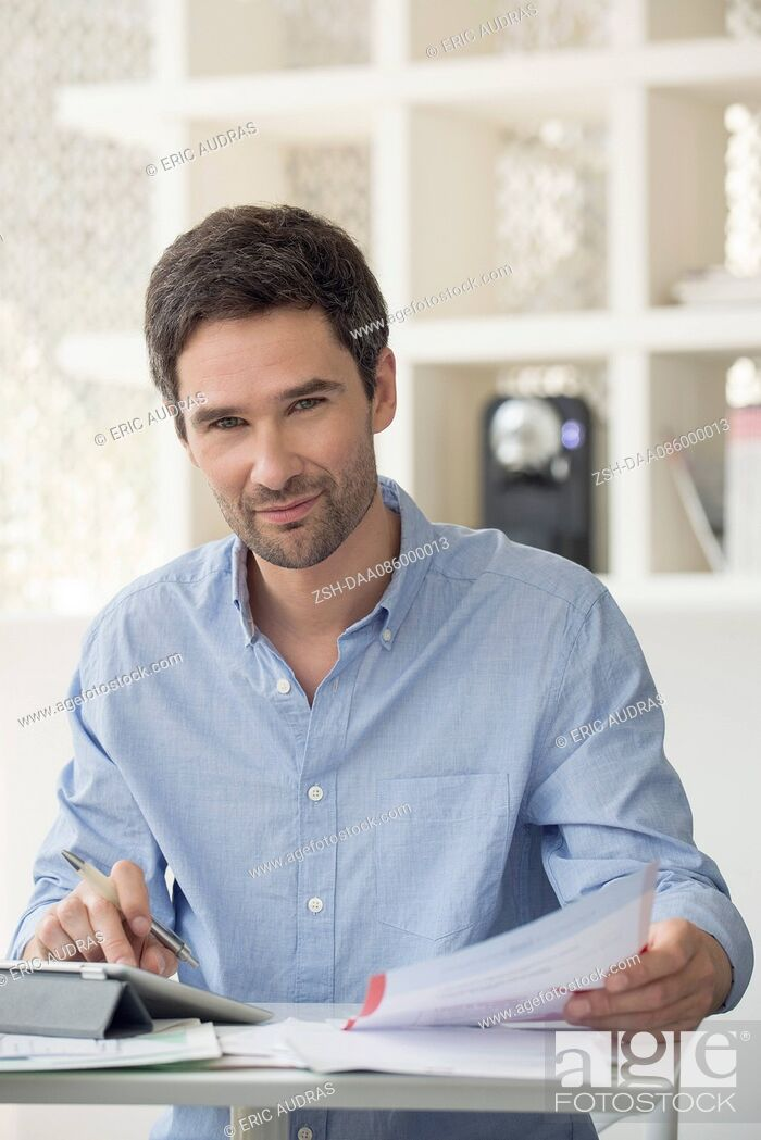 Stock Photo: Man using online banking to manage personal finances.