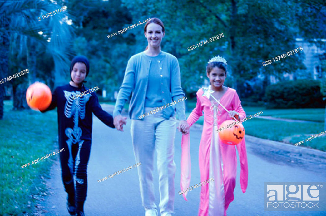 Stock Photo: Mother with her son and daughter in Halloween costumes.