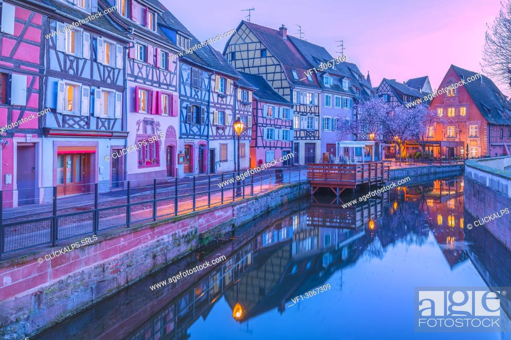 Stock Photo: Canal waterfront view of traditional townhouses at dusk, Colmar, France.
