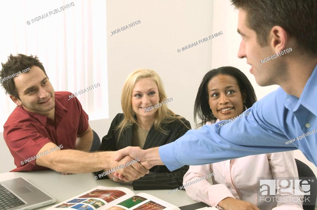 Stock Photo: Business Meeting With Shaking Hands.
