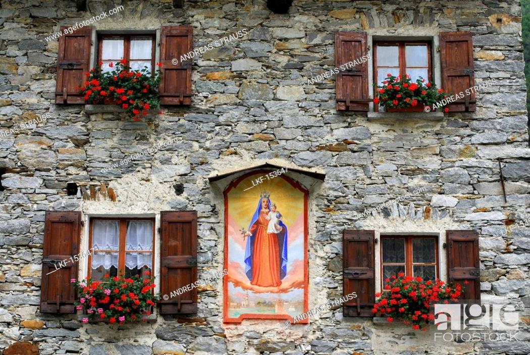 Stock Photo: Fascade with picture of the Virgin Mary, Sonogno, Valle Verzasca, Canton of Ticino, Switzerland.