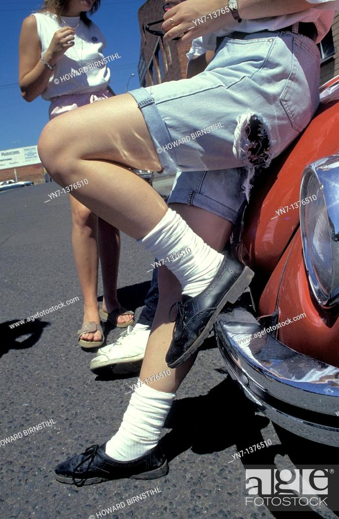 Stock Photo: symbolic shot of teenage life as kids lean on their car and wait for Godot.