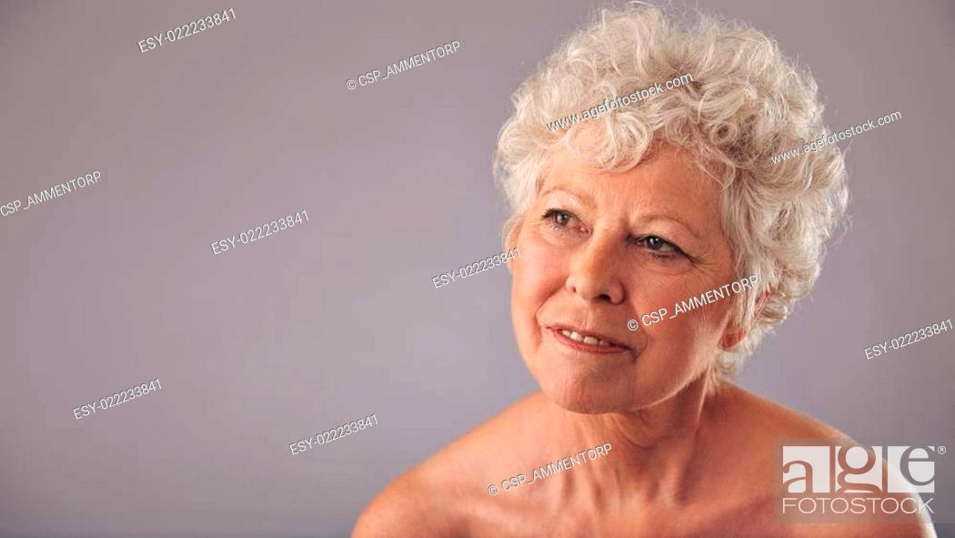 Stock Photo: Attractive senior woman daydreaming.