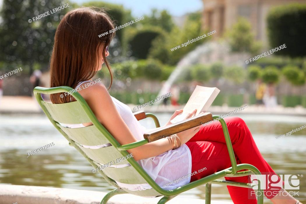 Stock Photo: Woman reading a magazine, Jardin des Tuileries, Paris, Ile-de-France, France.