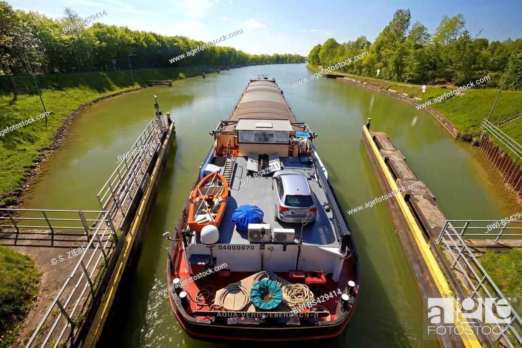 Stock Photo: barge leaving the lock Bevergern, Dortmund Ems Canal, Germany, North Rhine-Westphalia, Muensterland, Hoerstel.