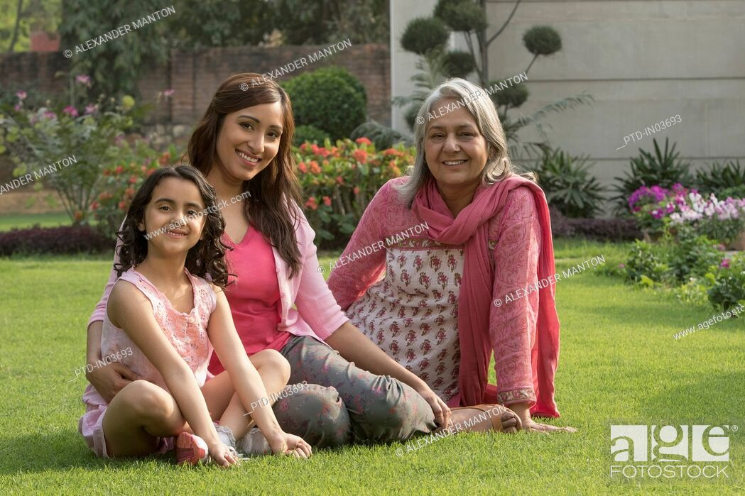 Stock Photo: Grandmother, daughter and grandchild (4-5) sitting in garden.