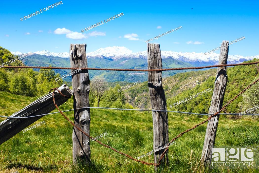Stock Photo: Rural fence in the mountains on the Alps, Mottarone, Stresa, Italy.