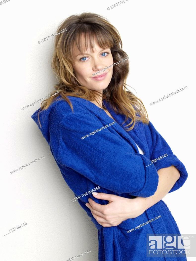 Stock Photo: Woman in blue bathrobe.