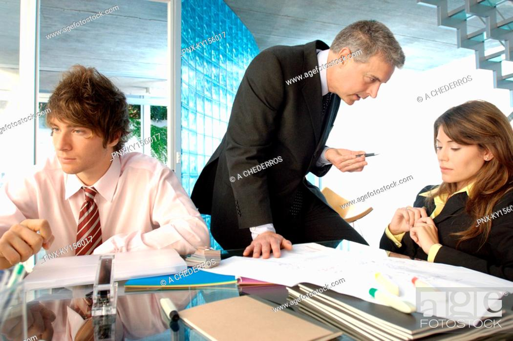 Stock Photo: Businessman discussing with colleagues in office.
