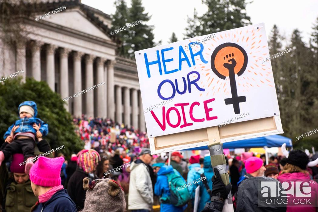 Stock Photo: Protesters and sign at the 2018 Women's Day March in Olympia at the Washington State Capitol; Olympia, Washington, United States of America.
