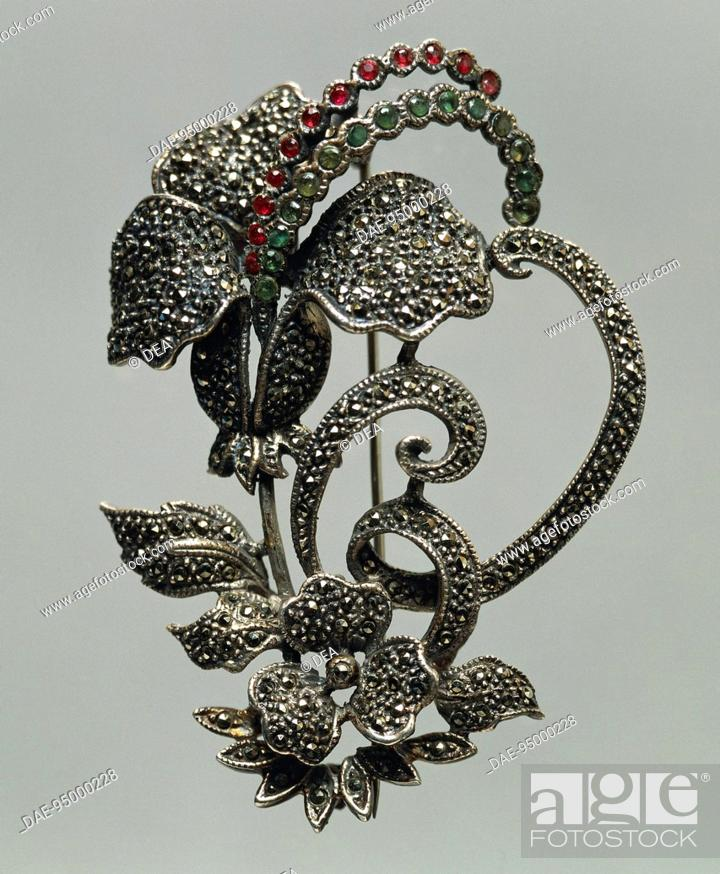 Stock Photo: Silversmith's art, Italy, 20th century. Bouquet-shaped silver brooch set with diamonds, rubies and emeralds, 1950s.  Private Collection.