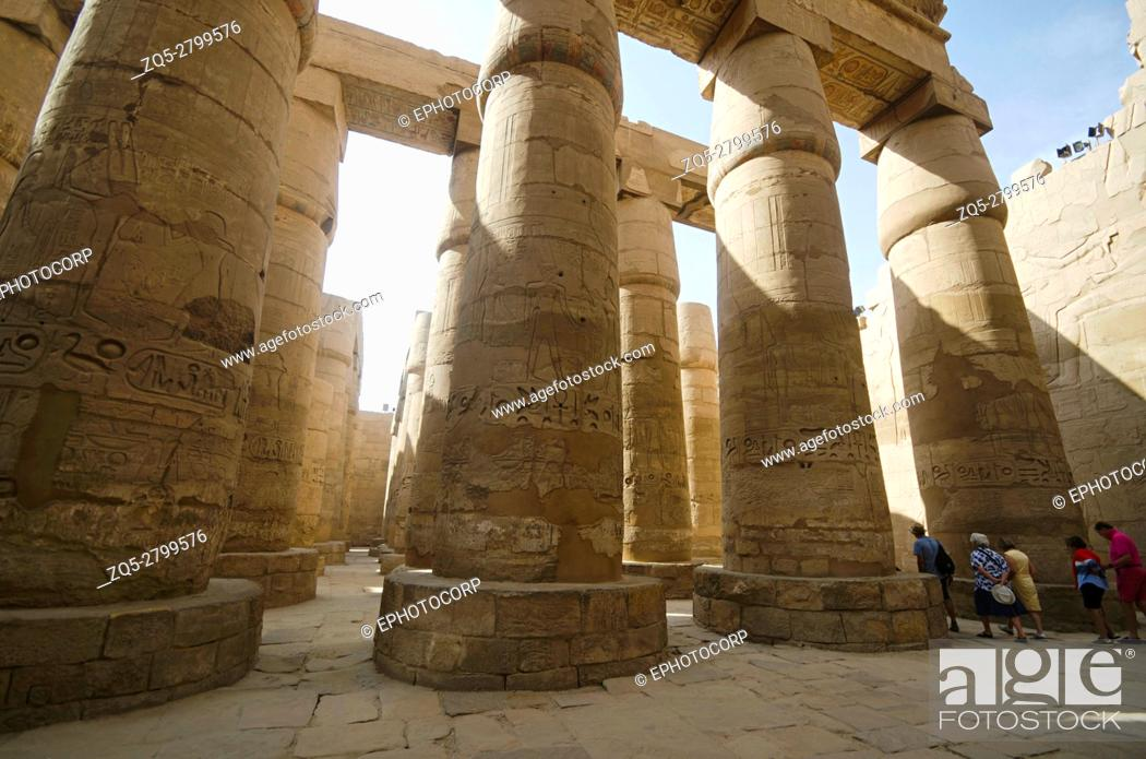 Stock Photo: Carved pillars, Built in Yellow Limestone, View of the great hypostyle hall in the Precinct of Amon Re, Situated at Karnak Temple complex.