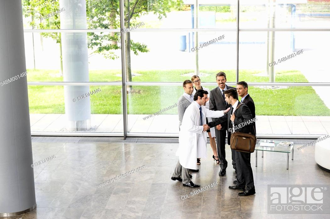 Stock Photo: Business people and doctors greeting.