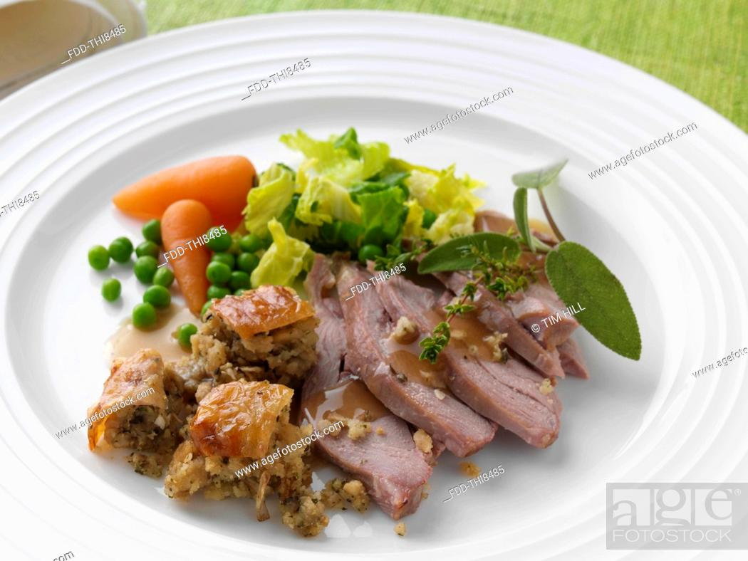 Stock Photo: Roast turkey thigh with stuffing carrots cabbage peas and gravy.