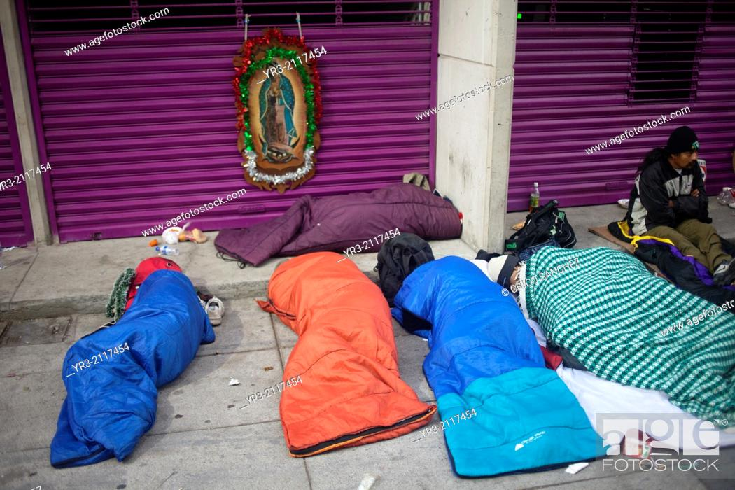 Stock Photo: Pilgrims sleep outside of the Our Lady of Guadalupe Basilica in Mexico City, Mexico, December 10, 2013.