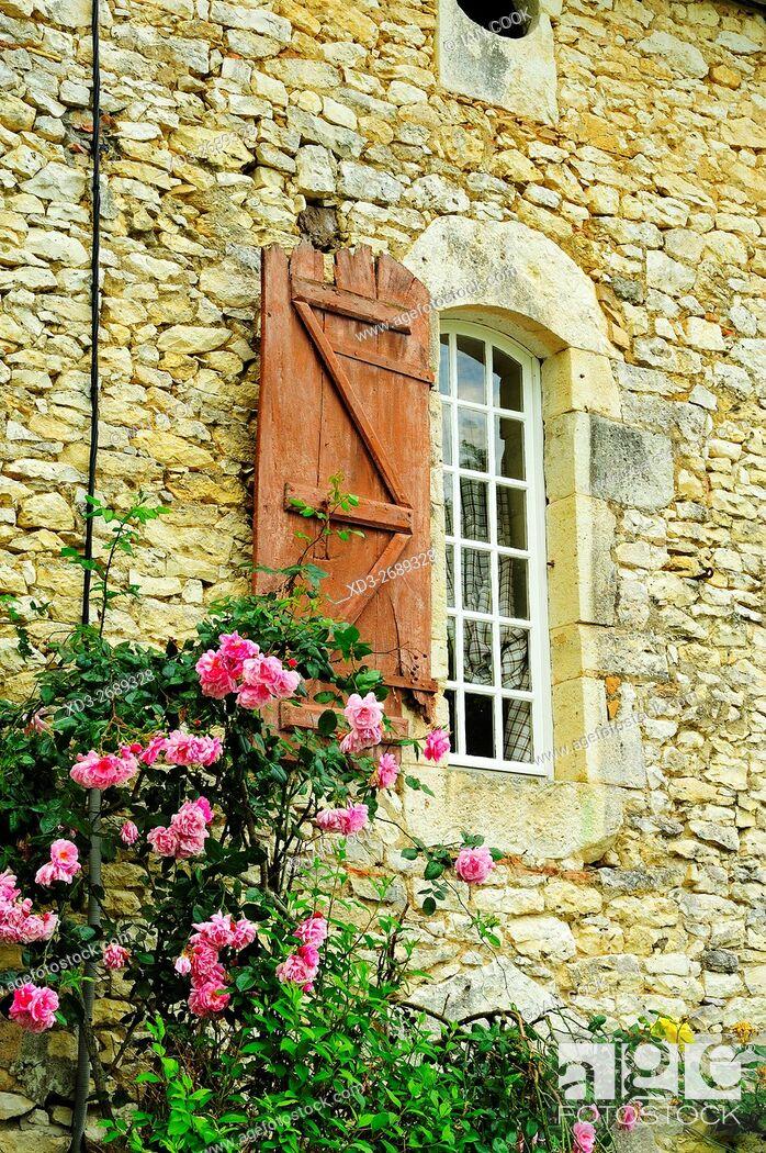 Stock Photo: shuttered window and roses, Bournel, Lot-et-Garonne Department, Aquitaine, France.