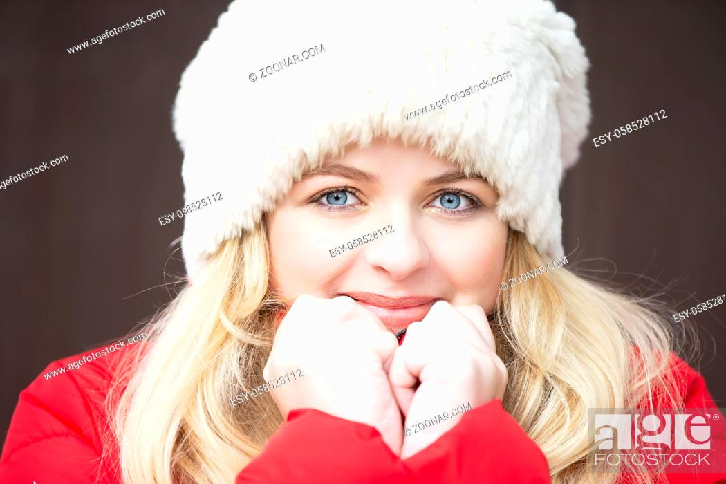 Stock Photo: Portrait of a beautiful blonde girl in a warm hat.