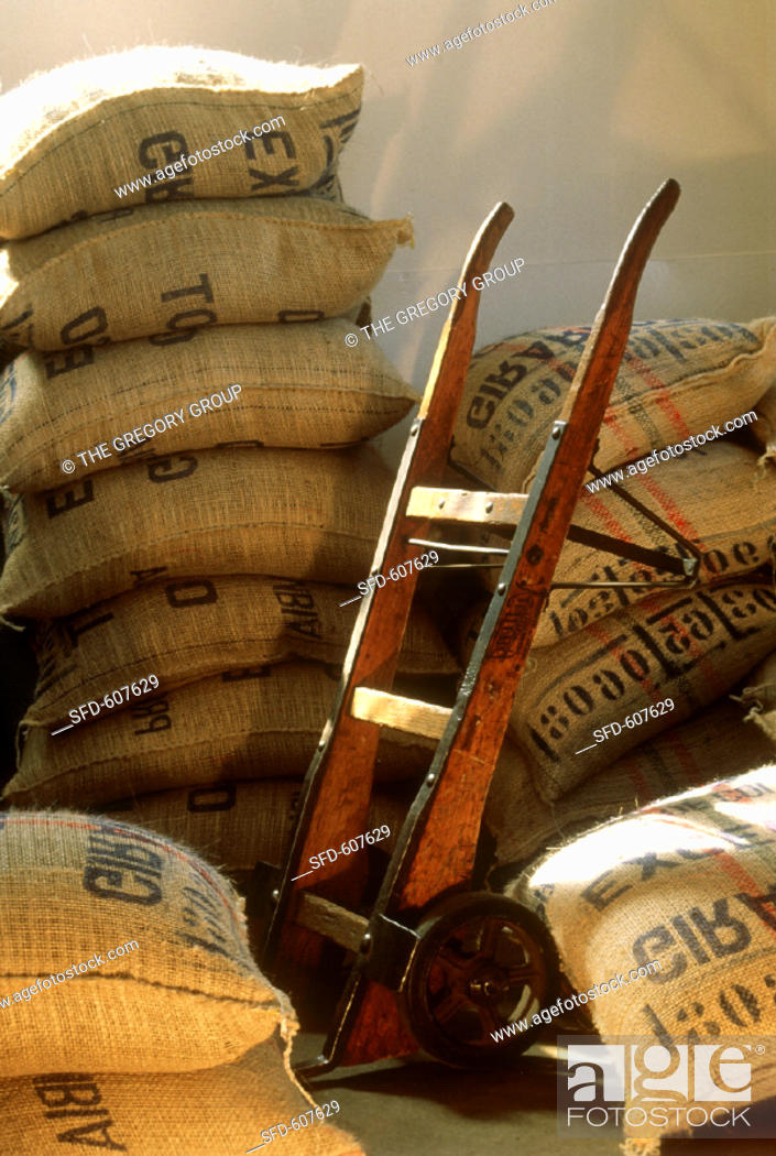 Stock Photo: Coffee Beans in Burlap Bags in Warehouse.