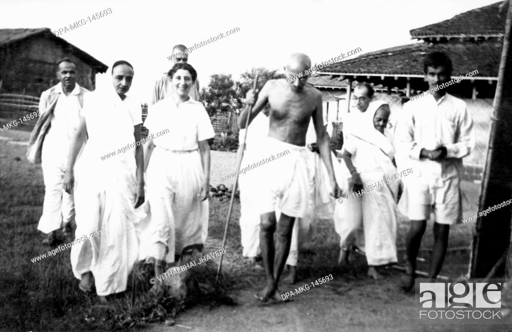 Stock Photo: Balwant Singh presents a newborn four hours old calf to Mahatma Gandhi and others at Sevagram Ashram , 1940 NO MR.