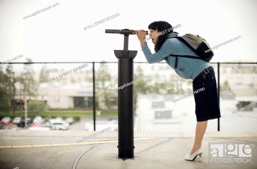 Stock Photo: Woman looking through telescope.