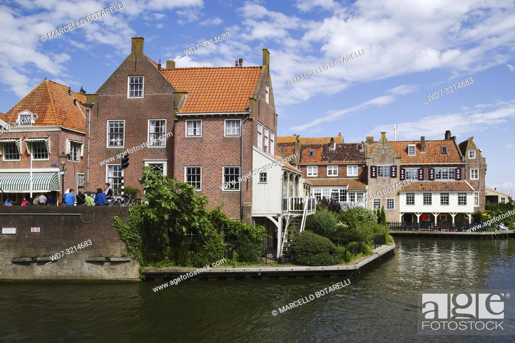 Stock Photo: Enkhuizen, small city of northern holland, historic buildings on the bank of the channel, under a blue sky with clouds.