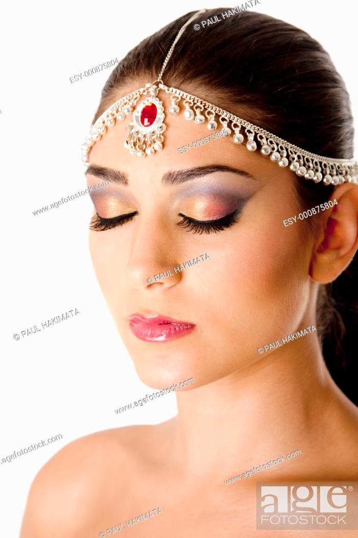 Stock Photo: Beautiful face of a Middle Eastern woman with Arabic style makeup and head jewelry, typacally used by Indian belly dancers, isolated.