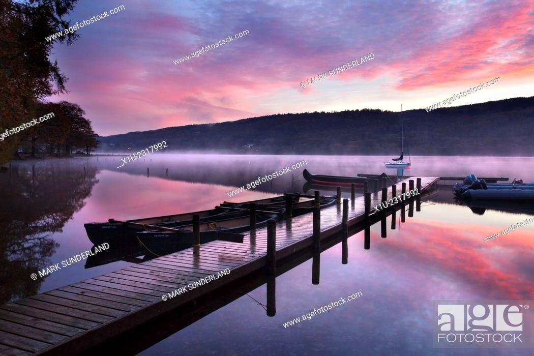 Stock Photo: Jetty and Boats at Dawn Coniston Water near Coniston Lake District Cumbria England.