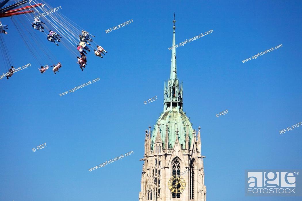 Stock Photo: Steeple of St Paul's church with carousel, Oktoberfest, Munich, Germany.