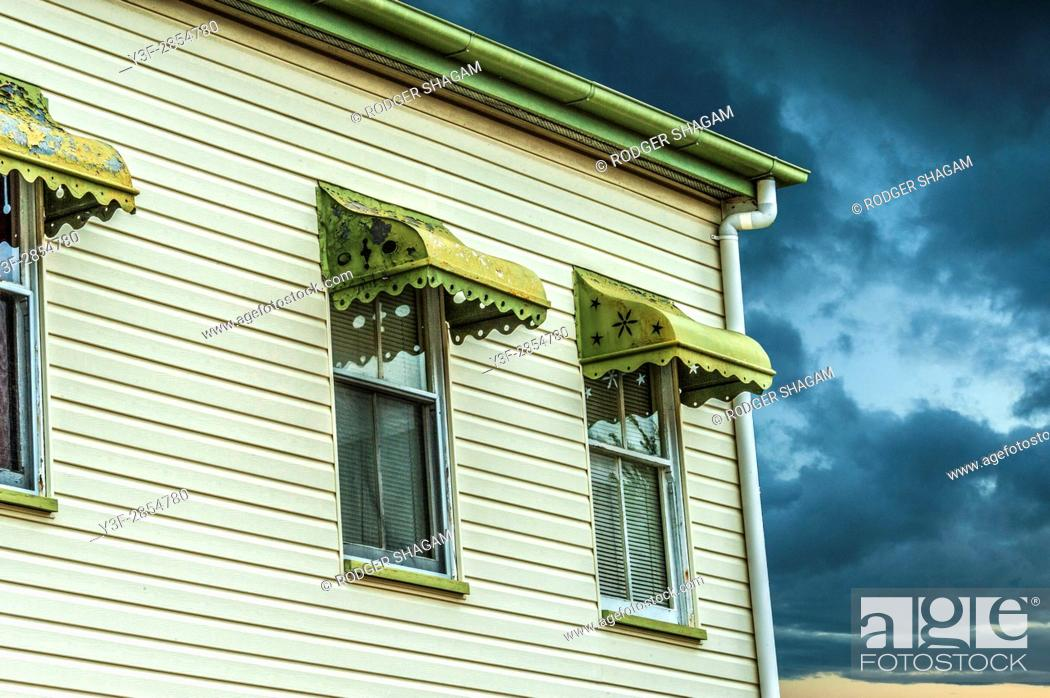 Stock Photo: A Queenslander house in an approaching storm.