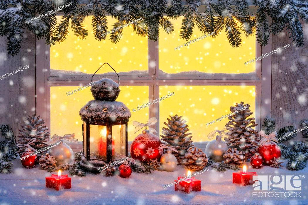 Stock Photo: Lantern with Christmas decoration on windowsill. Switzerland.