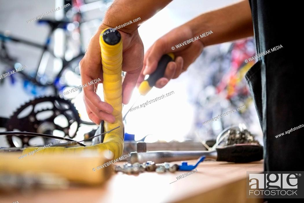 Stock Photo: Close-up of worker repairing bicycles.