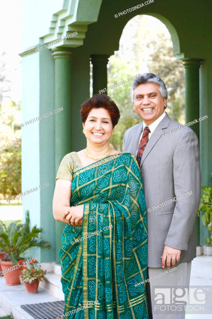 Stock Photo: Portrait of a mature couple smiling.