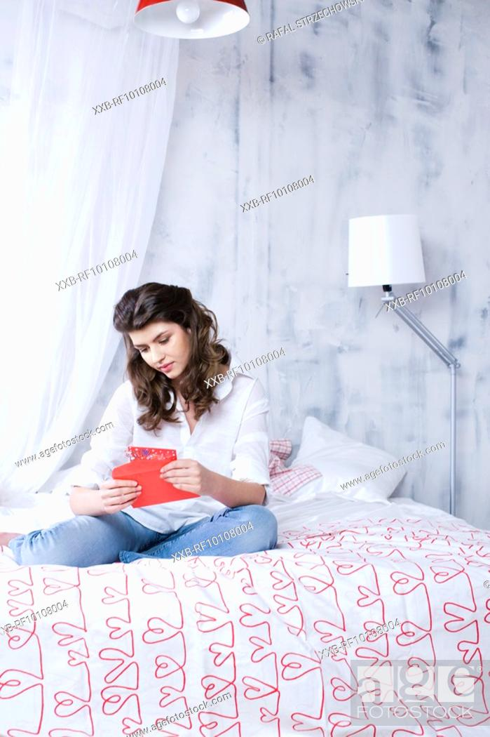 Stock Photo: Young woman with valentine card.