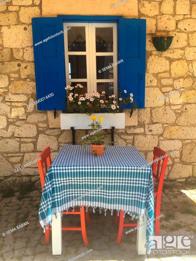 Stock Photo: Lonely table waiting for guests at the cafe in Alacati town, the historic centre of Zeytineli Koeyue, Cesme, Izmir, Aegean Coast, Turkey, Europe.
