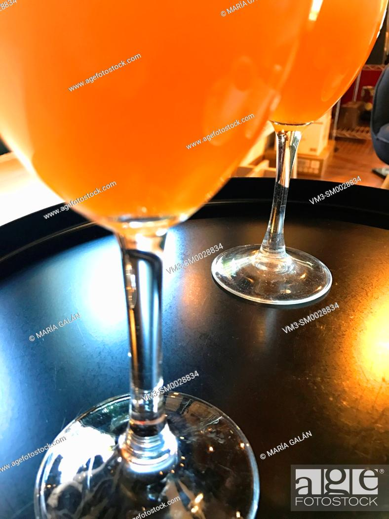 Stock Photo: Two glasses of orange juice. Close view.