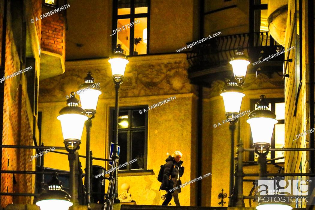 Stock Photo: Stockholm, Sweden A person walks at night on Malmskillnadsgatan.