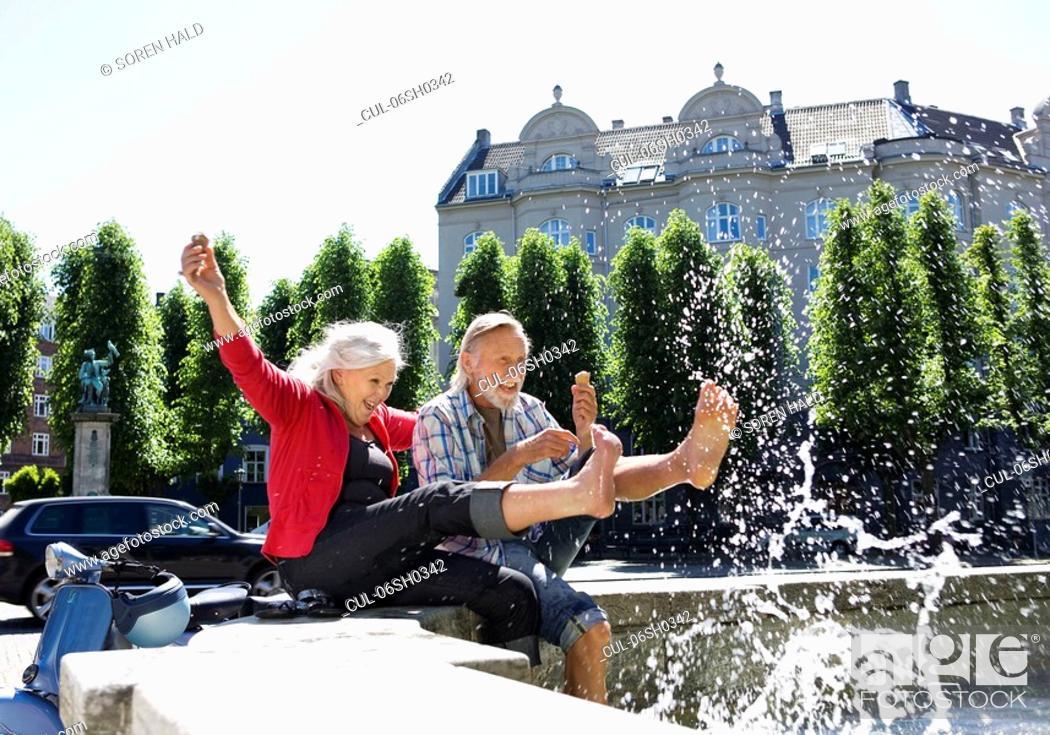 Stock Photo: Couple splashing water.