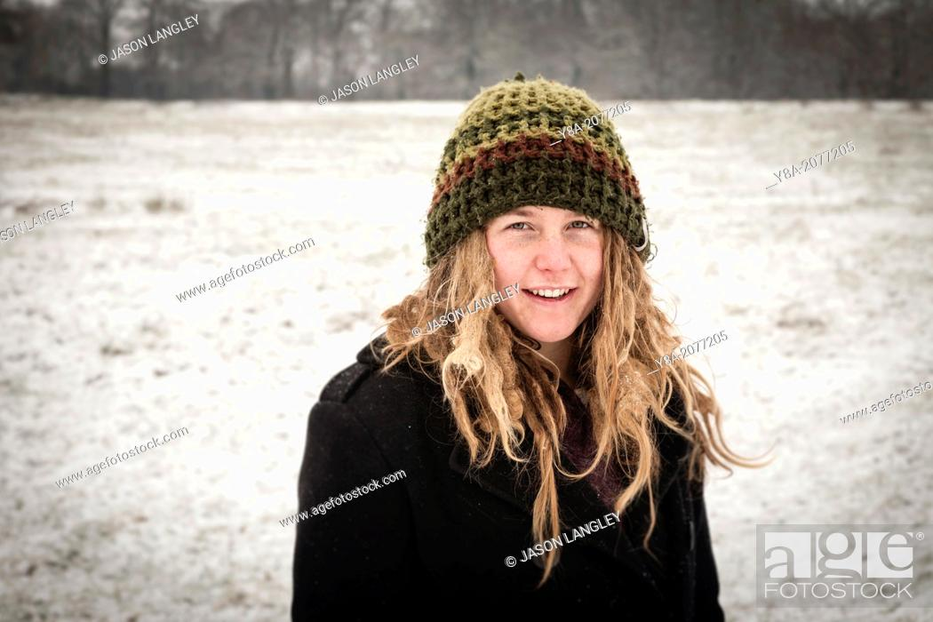 Stock Photo  Young woman with dreadlocks wearing a knit hat in the snow 6dc65b163e6
