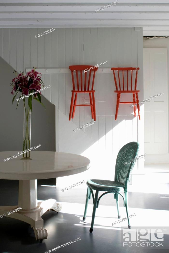 Kitchen With White Painted Pedestal Table Lloyd Loom Chair