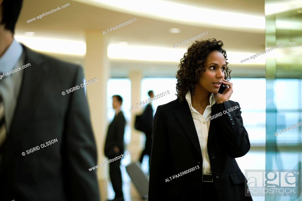 Stock Photo: Businesswoman talking on cell phone.