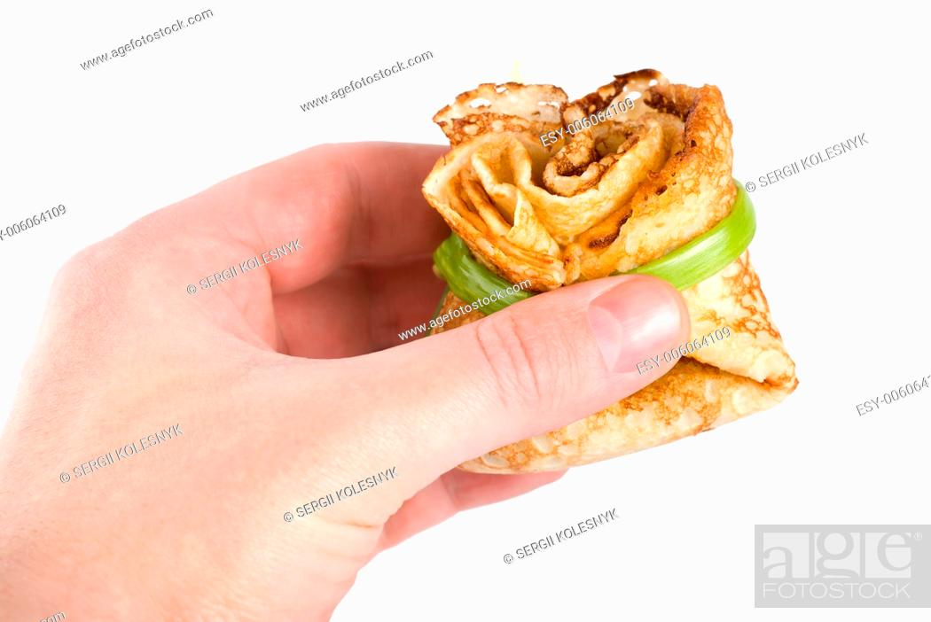 Stock Photo: Pancake in hand isolated on white background.