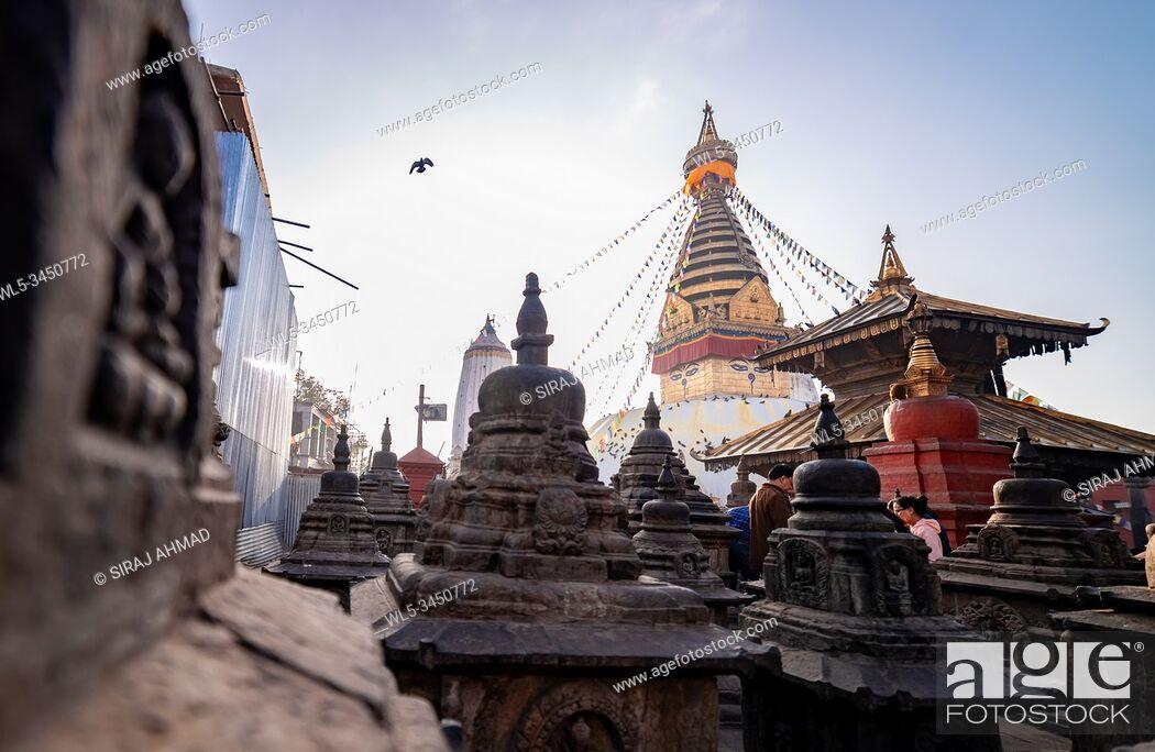 Stock Photo: Kathmandu, Nepal - November 17 2019 - Sunrise morning view of Swayambhunath Stupa or Monkey Temple Buddhist Monastery in Kathmandu, Nepal.