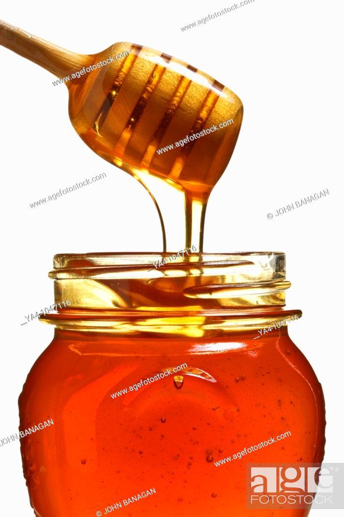 Stock Photo: Honey jar with honey ladle.