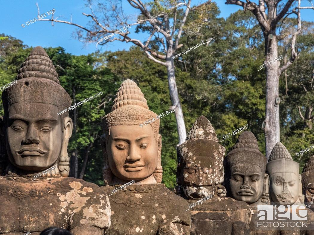 Stock Photo: Detail of the stone faces on the bridge at the south gate of Angkor Thom, Angkor Temples complex, Cambodia, Asia.