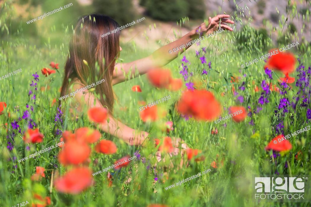Stock Photo: Beautiful Spring Young Woman Outdoors Enjoying Nature. Healthy Smiling Girl in flower Spring Meadow.