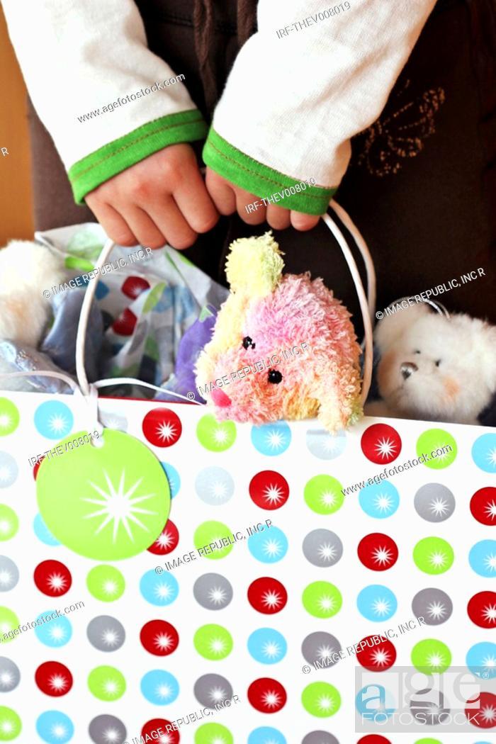 Stock Photo: dolls in handheld shopping bag.