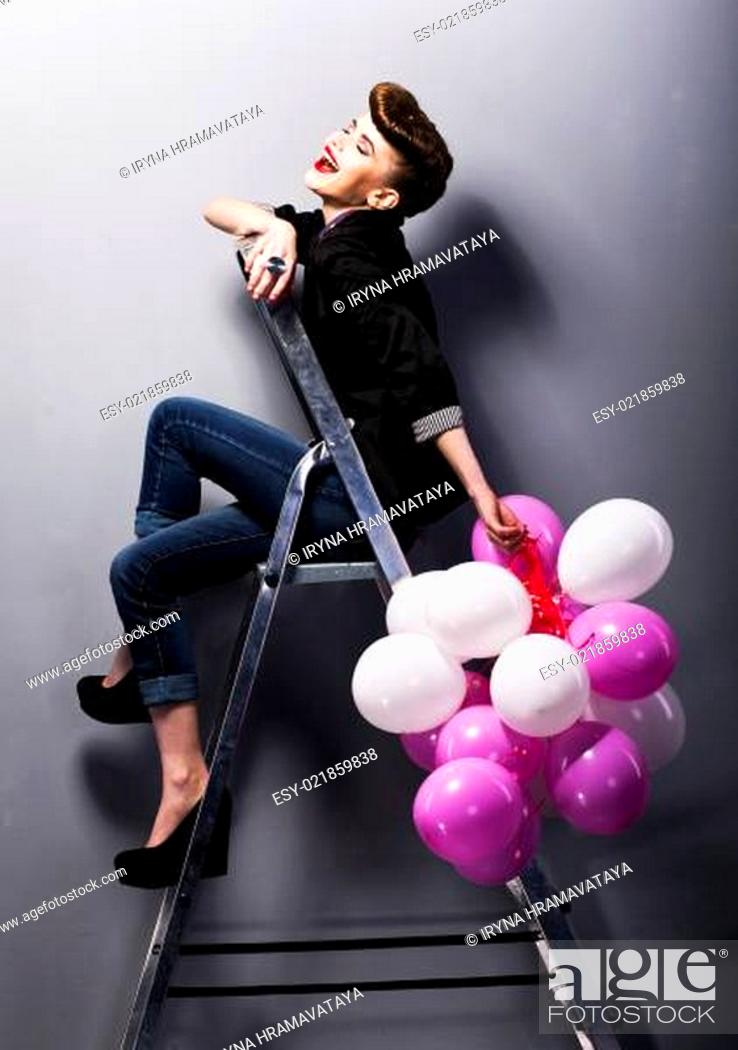 Stock Photo: Pretty cheerful fashion retro teen girl laughing on ladder.