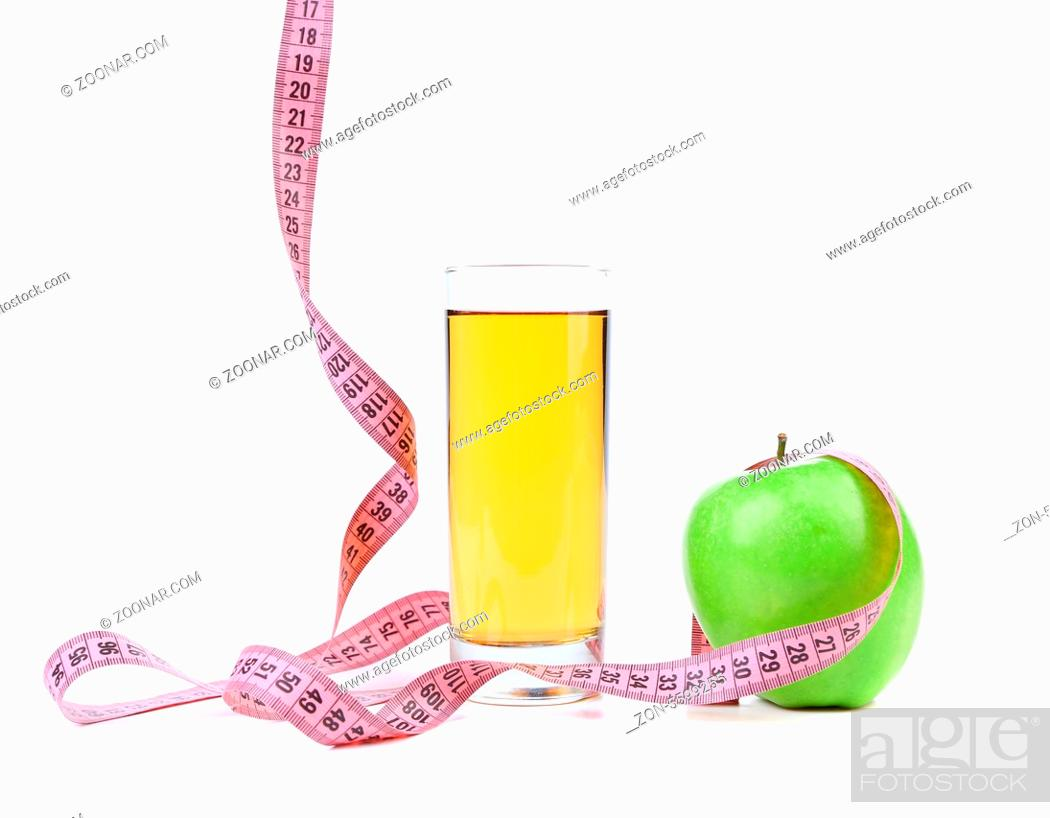 Stock Photo: Green apple and juice with measuring tape.